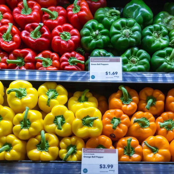 Different colored sweet peppers in the grocery store