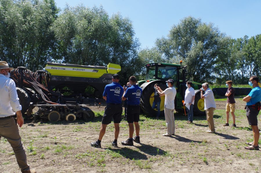 People watching a tractor demo